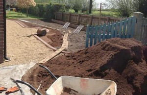 Preparing the graded topsoil to a fine tilth ready for new turf